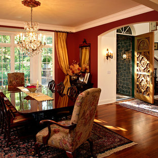 Photo of a large classic enclosed dining room in Minneapolis with red walls and dark hardwood flooring.