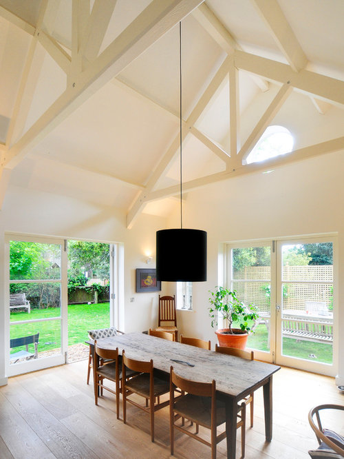 high ceiling room decoration. example of a transitional dining room design in oxfordshire with white walls high ceiling decoration y