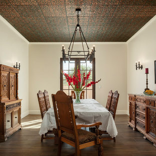Inspiration for a mid-sized southwestern ceramic floor and brown floor dining room remodel in Phoenix with beige walls
