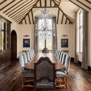 Imagen de comedor tradicional, extra grande, cerrado, con paredes beige, suelo de madera oscura y suelo marrón