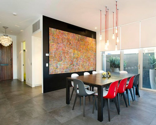 Inspiration for a contemporary dining room remodel in melbourne with black walls