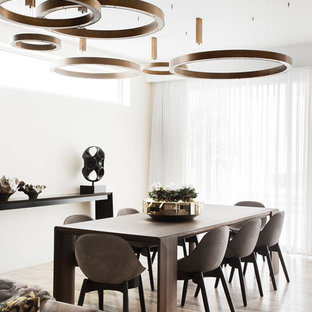 Photo of a contemporary dining room in Melbourne with white walls and beige floor.