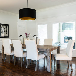 Dining room - large farmhouse brown floor and dark wood floor dining room idea in Dallas with white walls and no fireplace