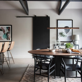 This is an example of a medium sized rustic dining room in Other with ceramic flooring, beige floors and a vaulted ceiling.