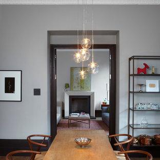 Foto di una sala da pranzo minimalista con pareti grigie