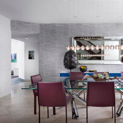 Large trendy travertine floor enclosed dining room photo in Miami with gray walls