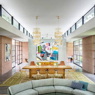 Example of a midcentury modern concrete floor and gray floor great room design in Houston with red walls