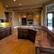 Mediterranean Dining Room by Capstone Custom Homes