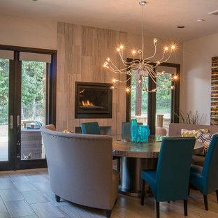 Foto de comedor de estilo americano, de tamaño medio, cerrado, con paredes beige, suelo vinílico, chimenea tradicional, marco de chimenea de baldosas y/o azulejos y suelo gris
