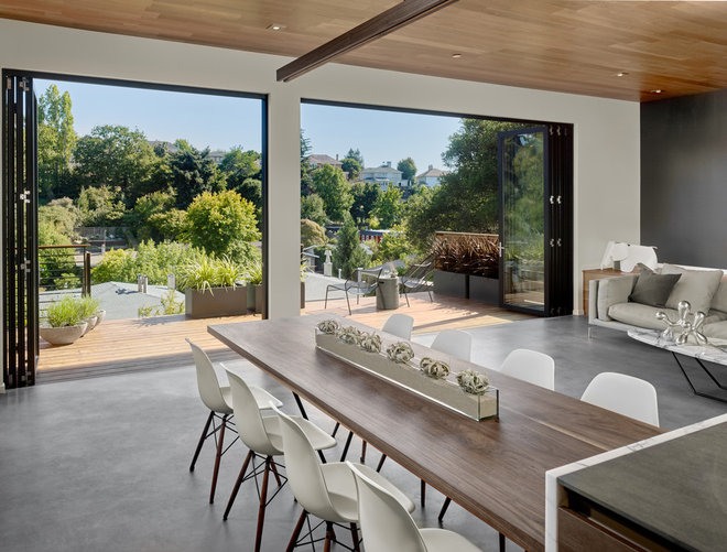 Midcentury Dining Room by Knock Architecture and Design