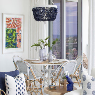 Dining room - beach style white floor dining room idea in Miami with white walls