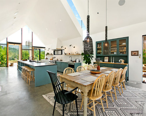 Inspiration For A Farmhouse Concrete Floor And Gray Great Room Remodel In Los Angeles With