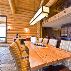 Rustic Dining Room by Sticks and Stones Design Group Inc