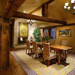 Southwest terra-cotta floor dining room photo in Santa Barbara