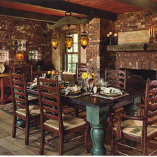 Rustic Dining Room by Denman Construction