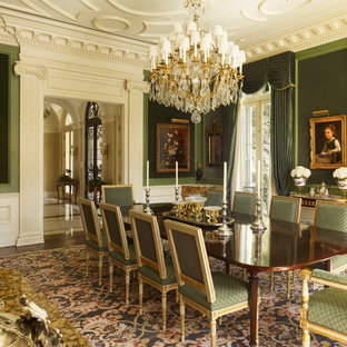 This is an example of a traditional enclosed dining room in New Orleans with green walls and dark hardwood flooring.