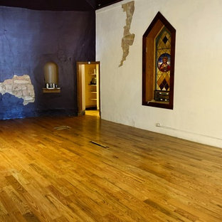 Inspiration for a huge 1950s light wood floor great room remodel in Denver with purple walls