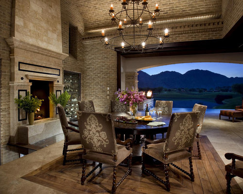 Tuscan Dark Wood Floor Dining Room Photo In San Diego With A Standard Fireplace