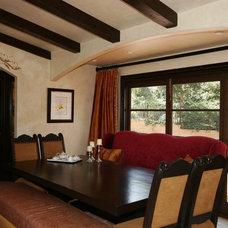 Mediterranean Dining Room by Dailinger Designs