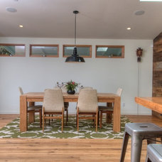 Midcentury Dining Room by Foley Development