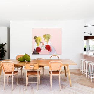 Midcentury open plan dining in Sydney with white walls.