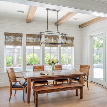 Open Dining Room with Exposed Beams and Views of the Pool