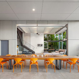 Example Of A Huge Minimalist Concrete Floor And Gray Floor Dining Room  Design In Seattle With