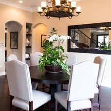 Mediterranean Dining Room by Belmont Design Group