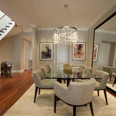 Example of a trendy dark wood floor and brown floor dining room design in Chicago with beige walls