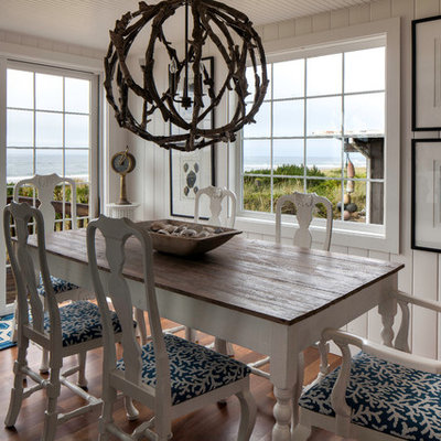 Inspiration for a coastal medium tone wood floor dining room remodel in Seattle with white walls