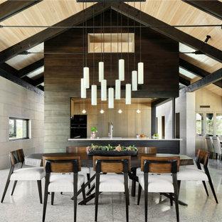 Modern inredning av ett mellanstort kök med matplats, med beige väggar, betonggolv och grått golv