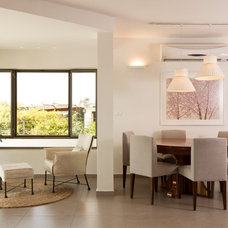 Contemporary Dining Room by ori ganon