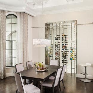 Dining room - mediterranean brown floor and dark wood floor dining room idea in Orlando with beige walls