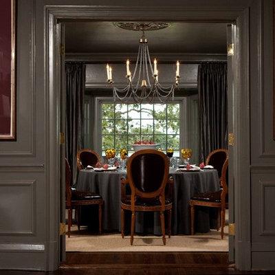 Large elegant dark wood floor enclosed dining room photo in Orlando with gray walls