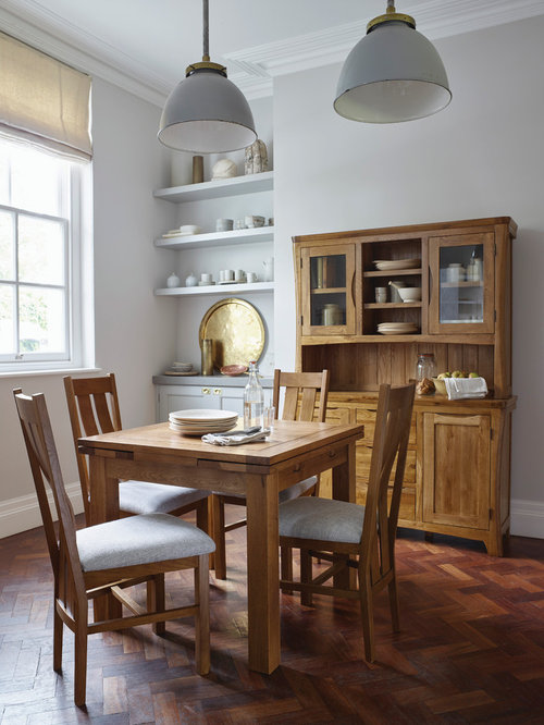 Small Farmhouse Dark Wood Floor Dining Room Idea In Wiltshire With Gray  Walls