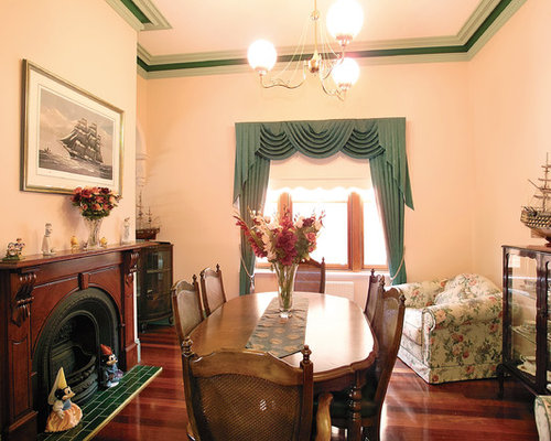 Mid Sized Elegant Enclosed Dining Room Photo In Melbourne With Multicolored Walls Medium Tone