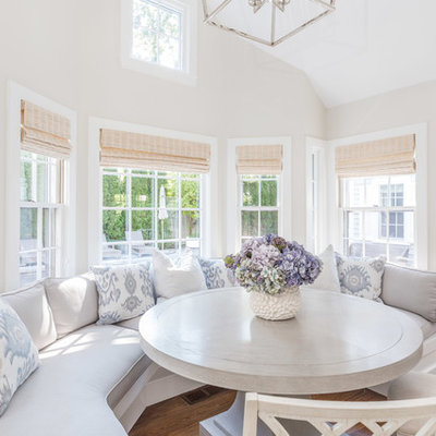 Inspiration for a small coastal medium tone wood floor dining room remodel in Boston with beige walls and no fireplace
