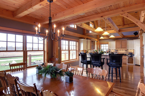 Traditional Dining Room by PineRidge Timberframe Inc.