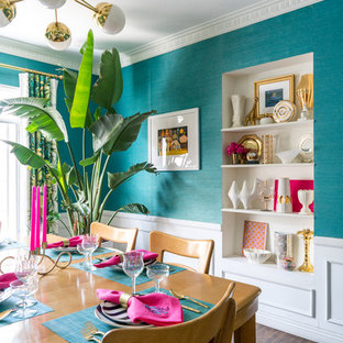 Inspiration for a small eclectic vinyl floor and brown floor enclosed dining room remodel in Los Angeles with blue walls
