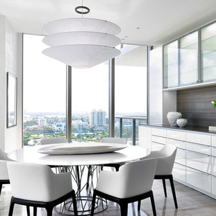 Enclosed dining room - mid-sized contemporary marble floor enclosed dining room idea in Miami with white walls