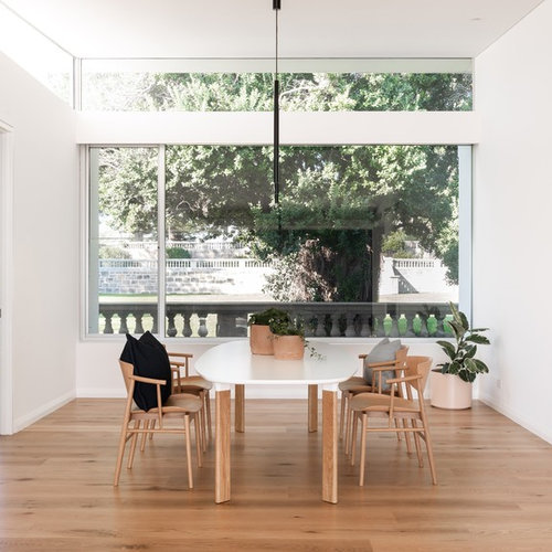 Design Ideas For A Modern Dining Room In Perth With White Walls, Medium  Hardwood Floors