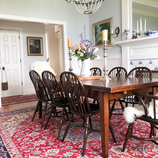 Inspiration for an eclectic enclosed dining room remodel in Bridgeport with blue walls, a standard fireplace and a tile fireplace