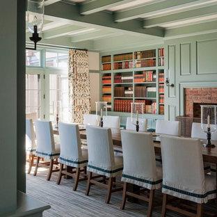 Foto de comedor clásico, extra grande, cerrado, con paredes verdes, moqueta, chimenea tradicional y marco de chimenea de ladrillo