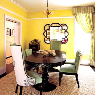Foto de comedor ecléctico con paredes amarillas