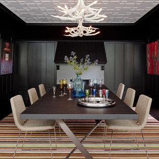 Ispirazione per una grande sala da pranzo classica chiusa con pareti nere, cornice del camino in mattoni, parquet scuro e nessun camino