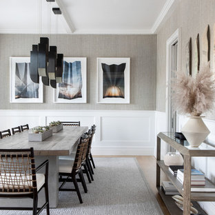Large transitional medium tone wood floor and brown floor enclosed dining room photo in New York with gray walls