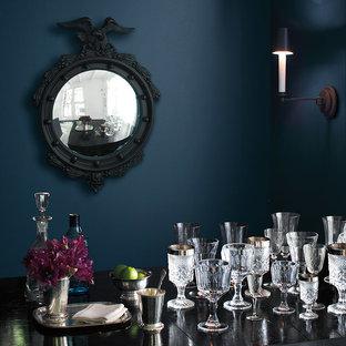 バンクーバーの中くらいのヴィクトリアン調のおしゃれな独立型ダイニング (青い壁、濃色無垢フローリング、暖炉なし) の写真