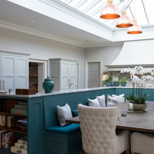 This is an example of a large traditional kitchen/dining room in Hampshire with grey walls and grey floors.