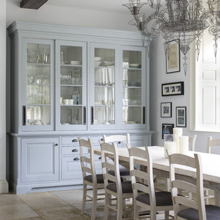 Large victorian dining room in Gloucestershire with limestone flooring.