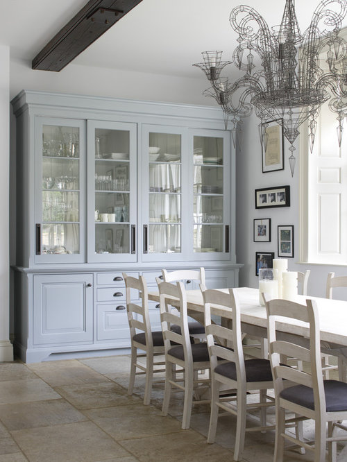 Example of a large ornate limestone floor dining room design in gloucestershire